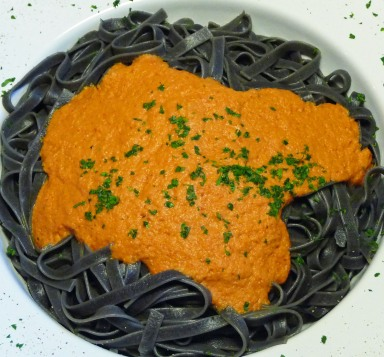 Black Pasta Topped w/ Roasted Pepper Sauce (c) jfhaugen