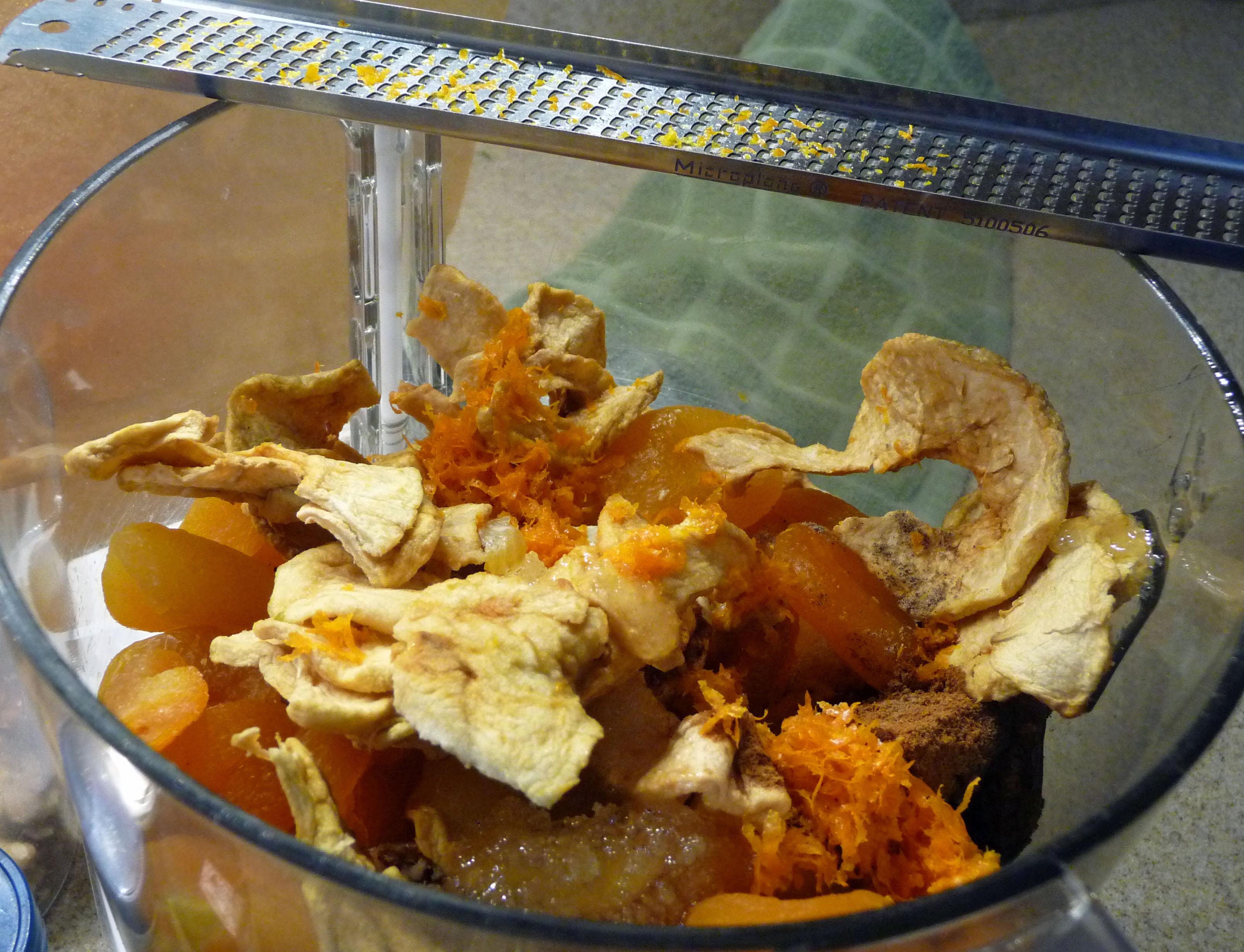 Dried fruit, honey, orange zest & spices in the food processor (c) jfhaugen